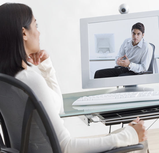Businesswoman on Video conference with Businessman
